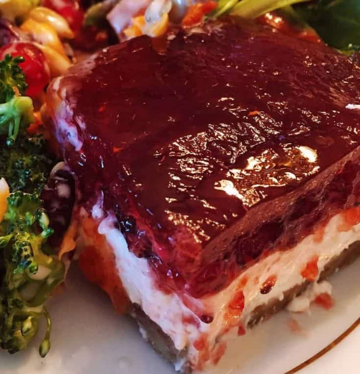 This is a delicious layered jello salad.  A golden crispy nutty crust is topped with a creamy layer of cream cheese and then topped off with a delectable cranberry orange gelatin. This salad can be made up to 2 days ahead of time.