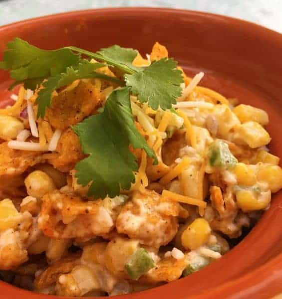 This Frito Corn Salad takes the deliciousness of creamy cheesy corn dip and makes it into one truly Amazingly unforgettable summertime salad!
