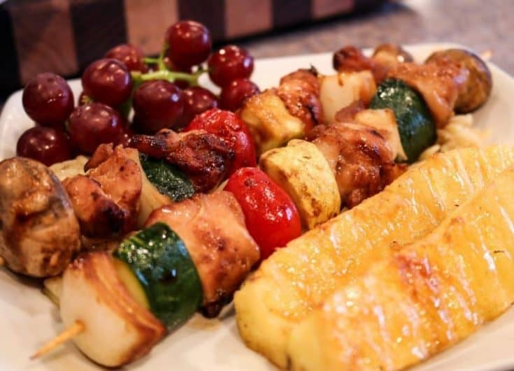 Teriyaki Chicken Kabobs are loaded with tender chunks of white chicken meat marinaded in a delicious teriyaki marinade and laced onto skewers with fresh vegetables and grilled to perfect. A quick easy and delicious summer time meal.