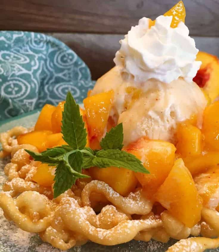 Who needs to go to the Fair for this favorite? Make your own delicious funnel cakes at home! Top with cinnamon sugar, peaches, and ice cream for one spectacular dessert!