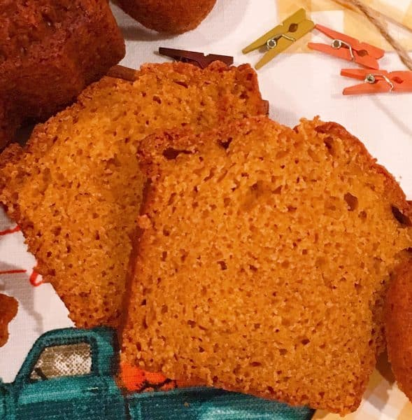 Two slices of moist pumpkin bread on a mat