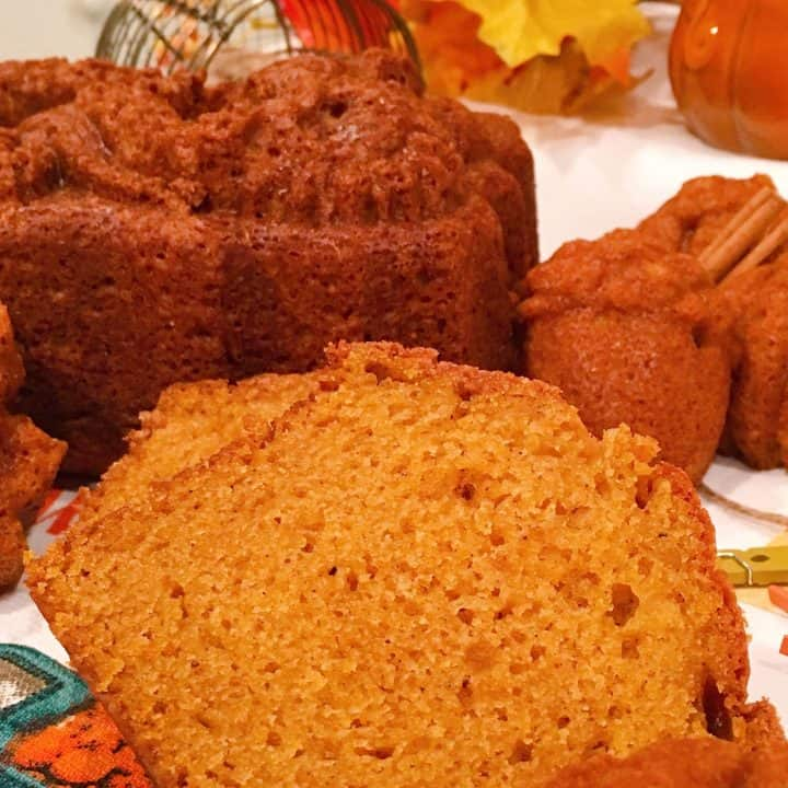 Sliced pumpkin bread and muffin on a mat