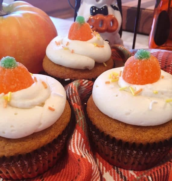Pumpkin cupcakes with cream cheese frosting and gummy sugar pumpkins