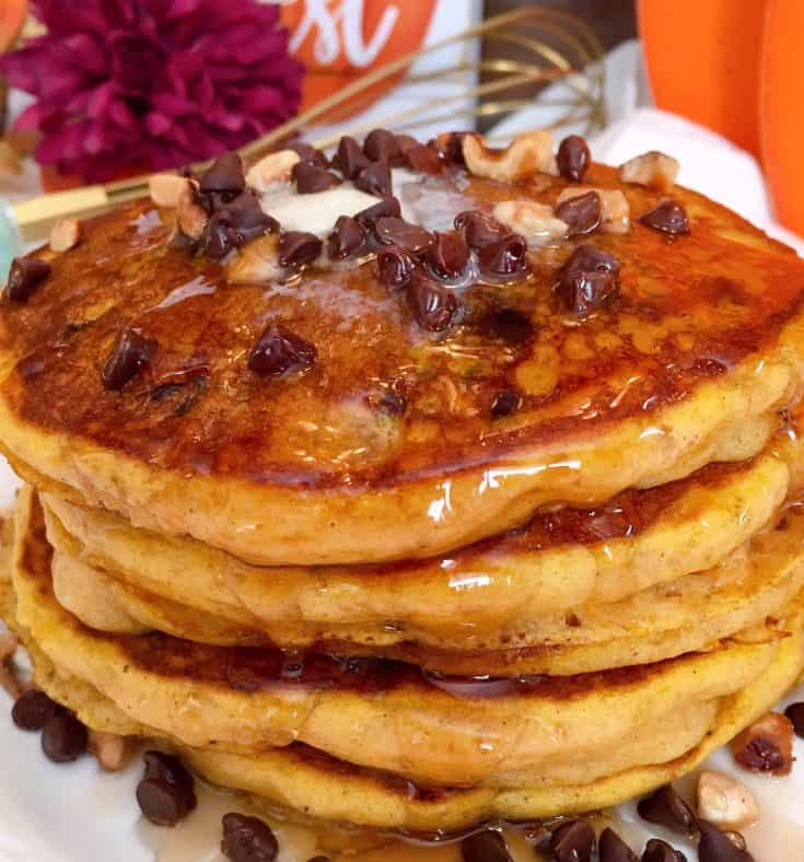 Light, fluffy, pumpkin chocolate chip buttermilk pancakes with hints of cinnamon and nutmeg, topped off with Maple syrup. The BEST Pumpkin pancakes on the planet!