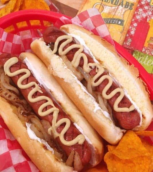 Seattle Dogs are tasty treat that take ordinary hot dogs to a whole new level. Toasted buns are spread with cream cheese, topped with caramelized onions, an all beef hot dog, and dijon mustard. A BBQ All-Star!