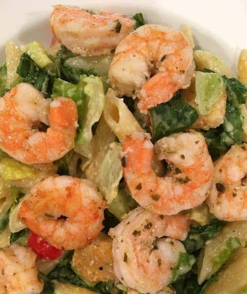 This salad is loaded with chopped romaine lettuce, crunchy croutons, grape tomatoes, diced avocado, penne pasta and delicious sauteed marinated shrimp for a dinner salad that's out of this world!
