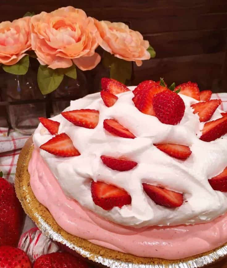 A Quick Easy Show Stopping Dessert that is light, creamy, and loaded with Strawberry flavor!