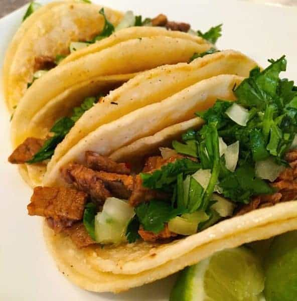 Street Tacos are mini tacos jammed packed full of flavor with simple toppings and can be eaten in 3-4 bites. This recipe is so easy and SO good!