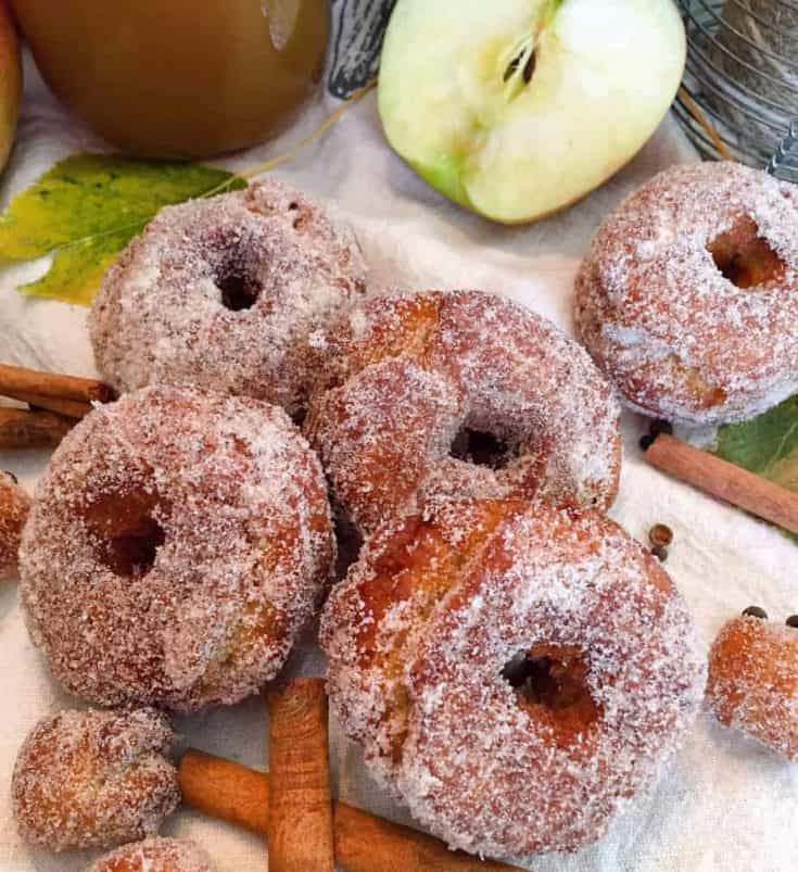 Fried Apple Cider Donuts are filled with the flavors of Fall! A scrumptious deep fried treat made with sweet tangy boiled apple cider with hints of warm spices! Tender and moist inside, golden and crispy outside.  The perfect Family Fall tradition!