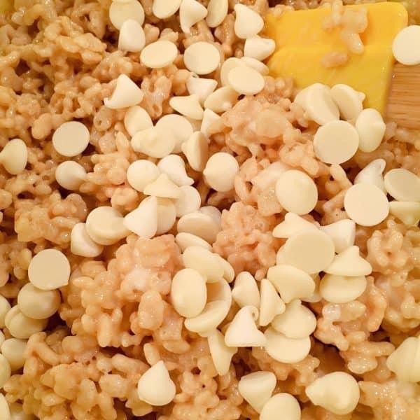 Adding white chocolate chips to rice krispie mixture