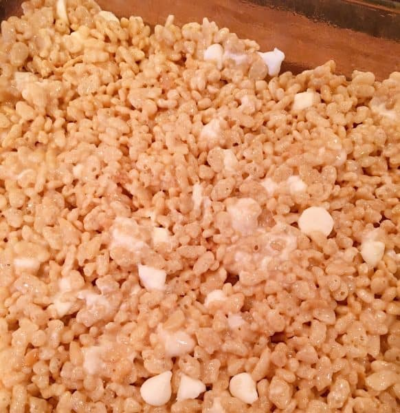 Rice Krispie Mixture poured into glass baking dish