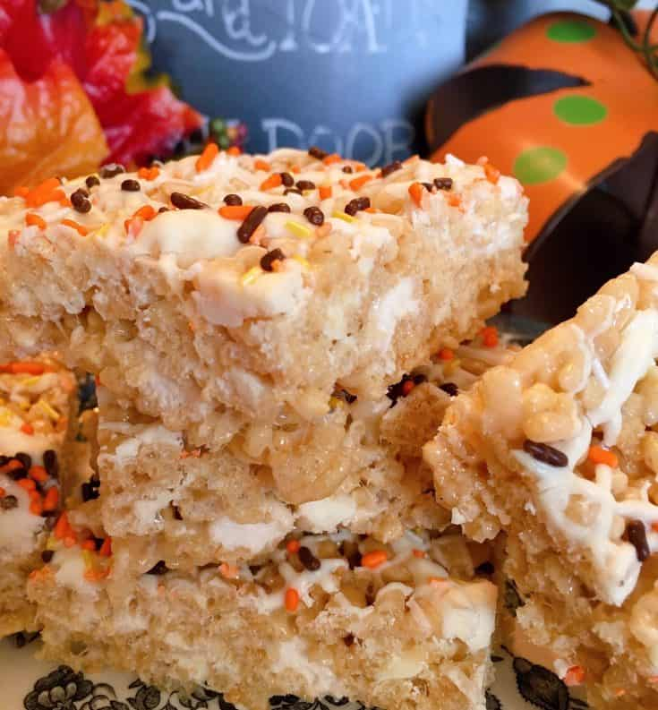 Chewy traditional rice krispie treats with maple flavored mini marshmallows and white chocolate chips drizzled with white chocolate and seasonal sprinkles. A delicious Fall treat.