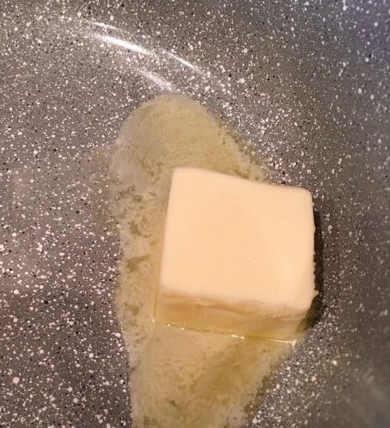 Butter melting in a sauce pan.