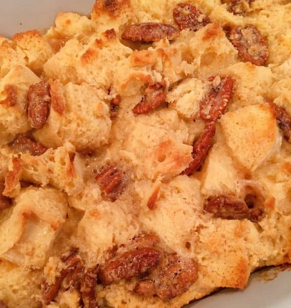 Baked Pecan Pie Bread Pudding in baking dish cooling on counter