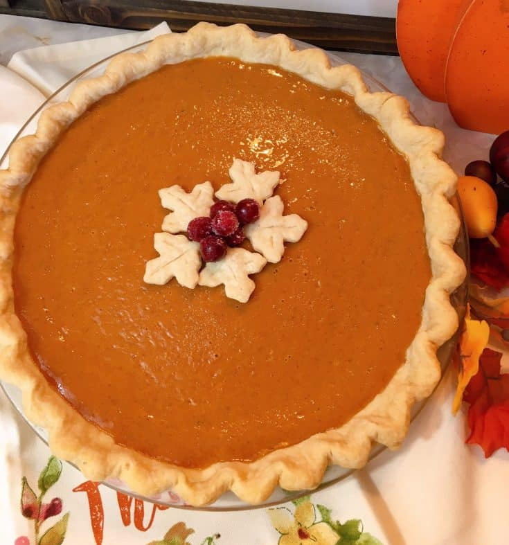 A rich custard like pumpkin pie with hints of delicious Fall spices, that is easy to make and less likely to crack on top. It's the perfect Pumpkin Pie!