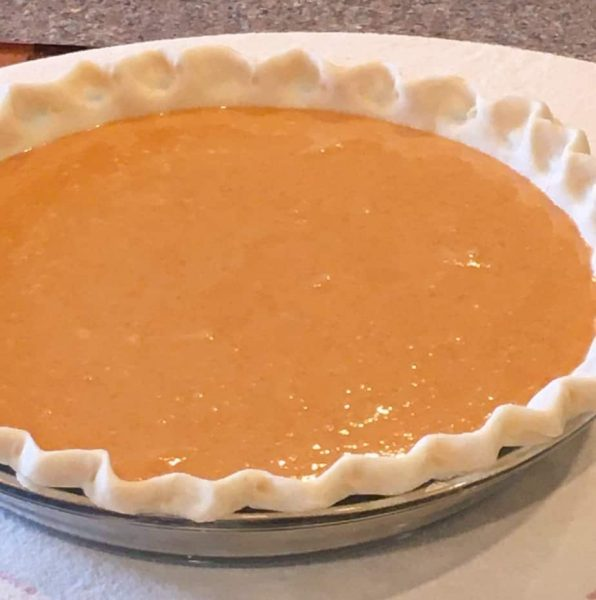 pie filling poured into pie crust.