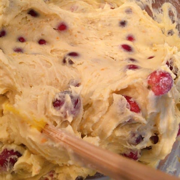 placing cake batter in baking pan
