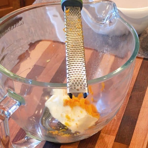 zesting one orange into mixing bowl