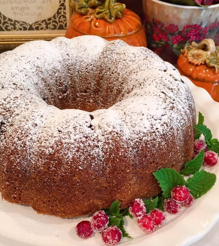 A delightfully moist, easy, and delicious pumpkin spice cake with fresh tart cranberries and a heavy sprinkle of confectioners sugar, come together to create this Old Fashioned Holiday Pumpkin Cranberry Bundt Cake!