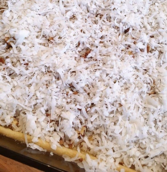 Pecans and Coconut on crust in baking dish