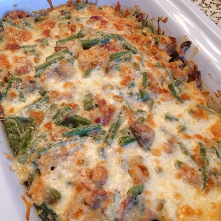 Fresh Green Bean Casserole is loaded with fresh tender green beans, bacon, mushrooms, green onions, croutons, and creamy garlic dill sauce and lots of melted cheese! It's truly the most delicious side dish EVER!