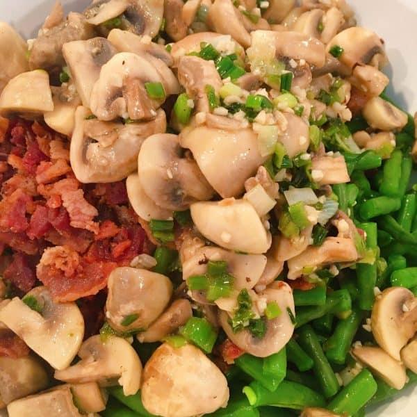 Adding mushroom mixture to green beans