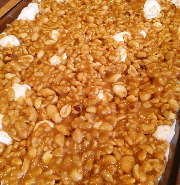 Chewy peanut topping spooned over marshmallows