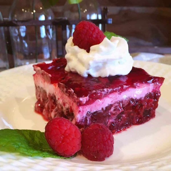Cut slice of Raspberry Layered Jello Salad