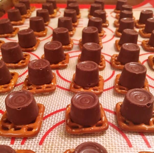 chocolate caramel candies on top of pretzels