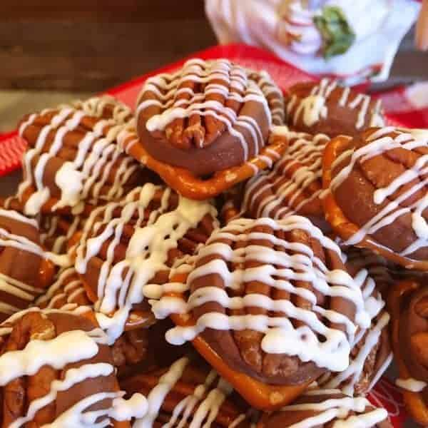 Salty and Sweet these Rolo Pretzel Turtle Bites are the perfect Holiday treat. Great as a neighbor or teacher gift. The sweet lovers in your life will love these delicious little bites of chocolate, caramel, and pecans perched on top of a salty pretzel.