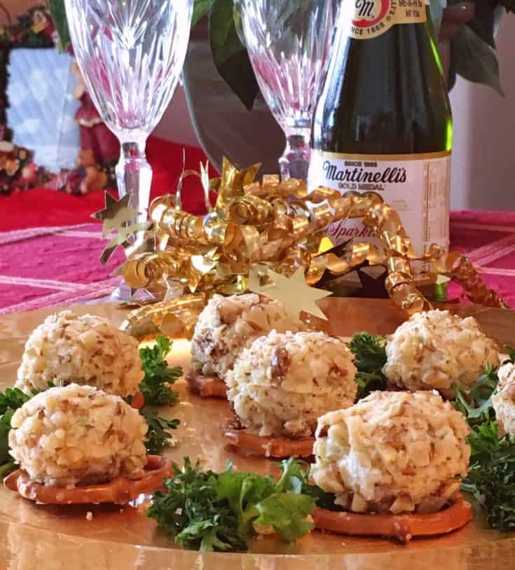 Mini blue cheese balls made with scrumptious cream cheese, green onion,tangy blue cheese and shredded sharp cheese, rolled in toasted chopped walnut and served on top of mini twisted pretzels. A heavenly Holiday appetizer perfect for entertaining!
