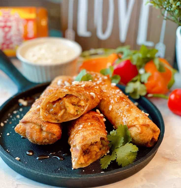 Egg Roll wrappers stuffed with crispy breaded chicken, celery, green onion, cilantro, and blue cheese or feta mixed with Copy Cat Wingers Buffalo sauce. They all come together to create these delicious and fun Sticky Buffalo Chicken Egg Rolls!
