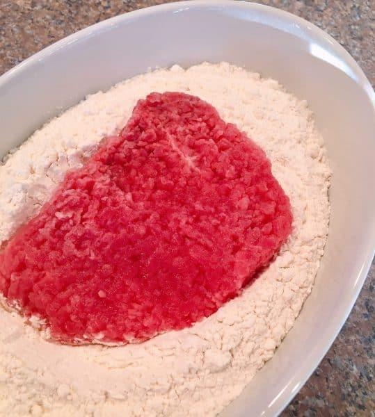 dredging cube steak in flour