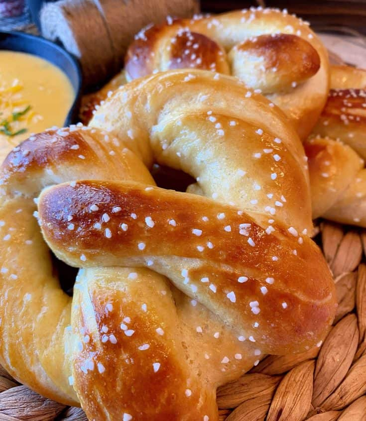 Homemade soft buttery Pretzels with an amazing Salsa Verde Cheese Dipping Sauce. They're so easy to make you'll wonder why you waited so long to make this delicious treat at home!
