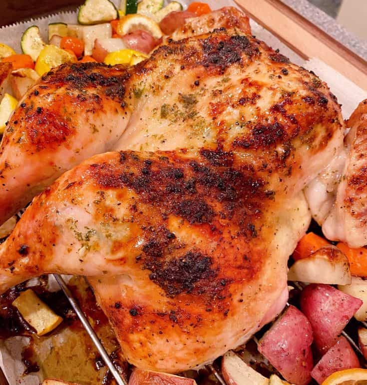 A simple Roasted Spatchcock Chicken with a fresh lemon, garlic and herb seasoning and roasted vegetables, bursting with flavor, tender and juicy. A fantastic easy dinner recipe your entire family will love!