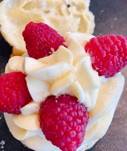 Adding Fresh Raspberries to cream filling