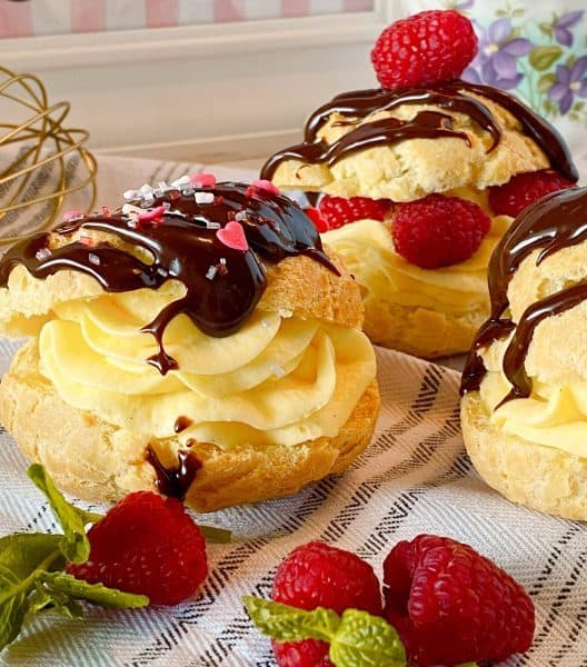 Valentine sprinkles on Cream Puffs with chocolate