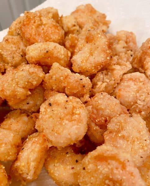 fried shrimp draining on paper towel