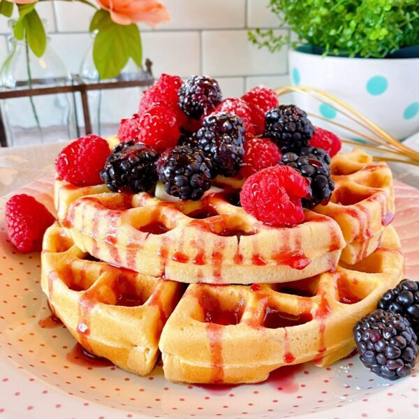 Stacked belgian waffles with berries
