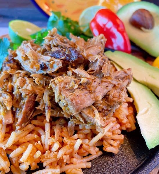 Pork Roast over spanish rice with toppings