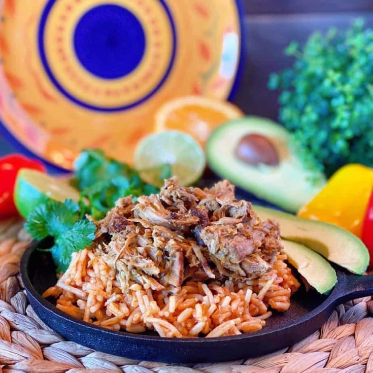 Pork Roast is slowly cooked in a delicious Mojo sauce made from garlic, citrus, cumin, and olive oil. Mojo is a traditional colorful Cuban vinaigrette that adds amazing flavor to this simple, yet delicious shredded Cuban Pork. Served over rice it's the perfect meal!