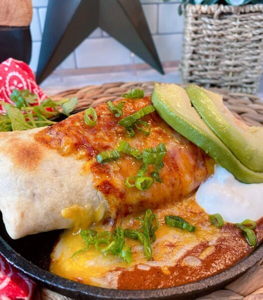 Oven Fried Chimichanga on plate with avocado and sour cream