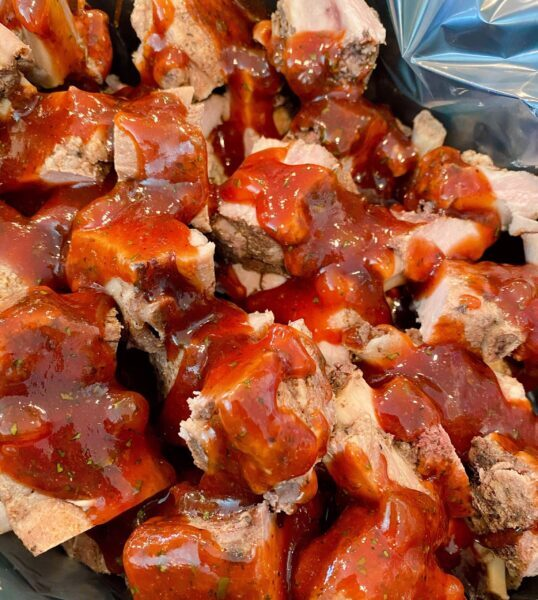 BBQ Sauce over the top of the riblets