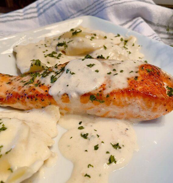Creamy Tuscan Salmon with Lobster Ravioli