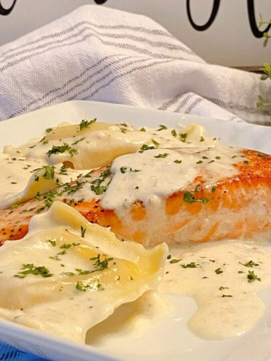 Creamy Tuscan Salmon with Lobster Ravioli