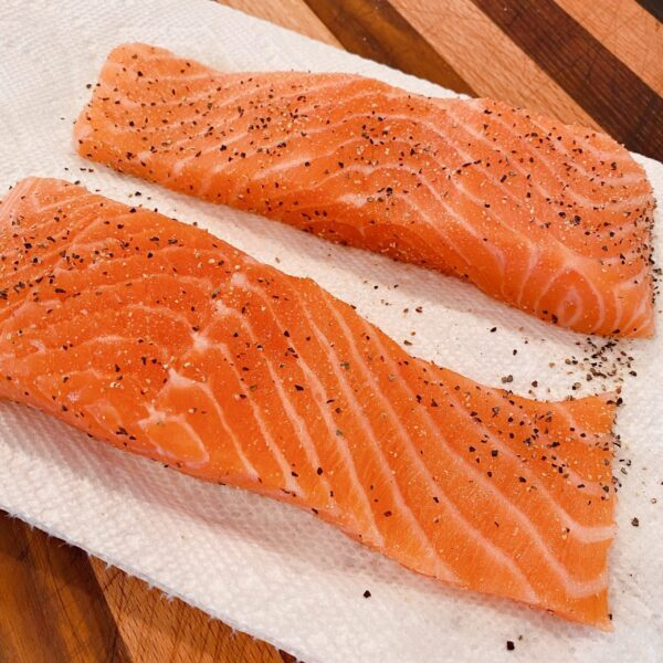 Salmon Fillets rinsed and on a paper towel seasoned with salt and pepper.