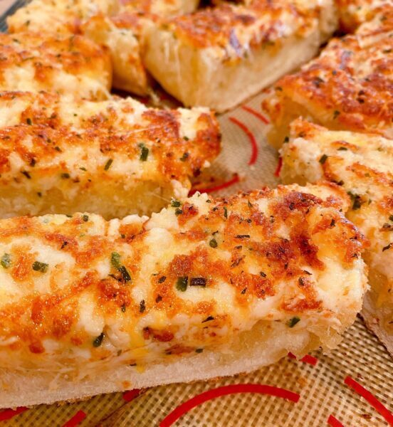 Sliced Cheesy Garlic Bread out of the oven