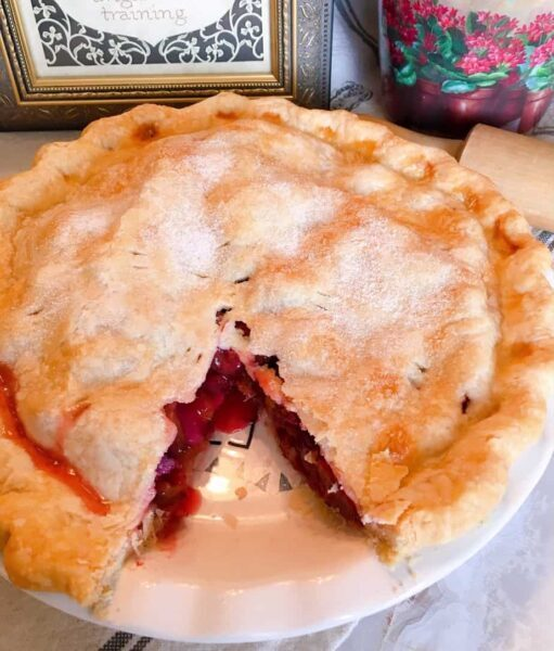 Plum Pie with a slice cut out of the pie.
