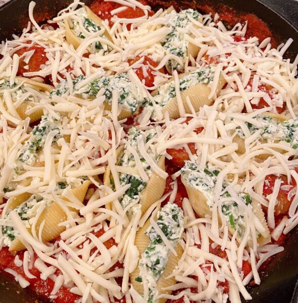 Top the shells and meatballs with remaining pasta sauce and cheese.