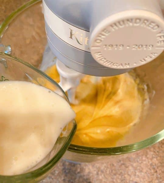 Adding room temperature buttermilk to wet ingredients.